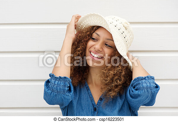 Attractive woman wearing hat and smiling on white background - csp16223501
