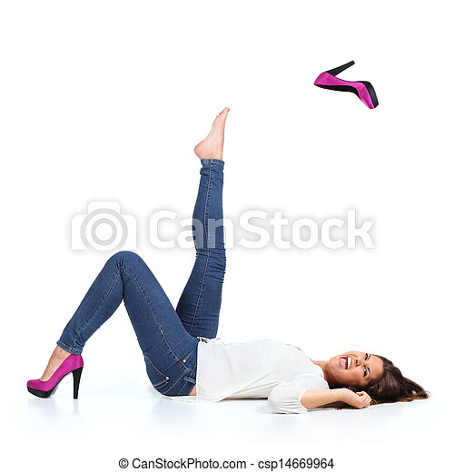 Attractive woman with jeans  throwing a fuchsia heel - csp14669964