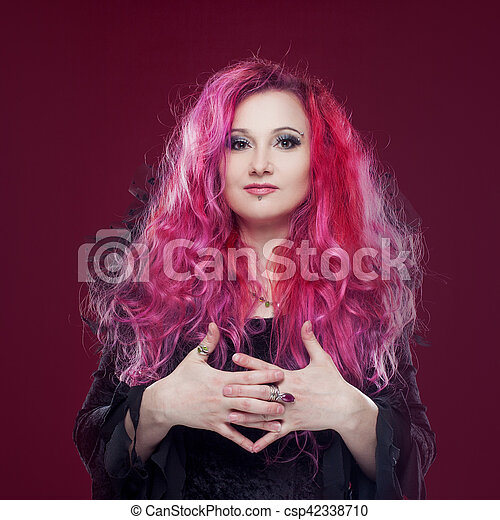 Attractive woman with pink hair in witch image. Halloween style - csp42338710
