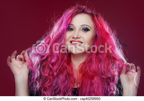 Attractive woman with pink hair in witch image. Halloween style - csp40258950