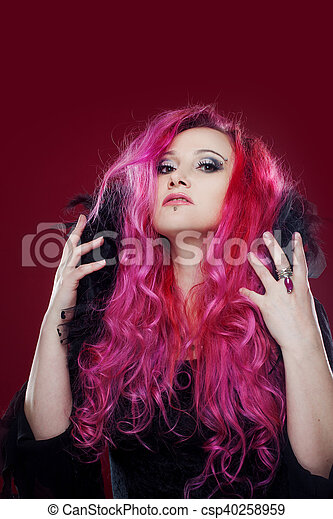 Attractive woman with pink hair in witch image. Halloween style - csp40258959