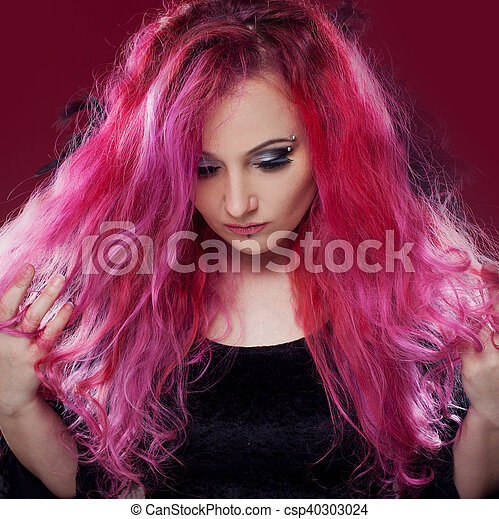Attractive woman with pink hair in witch image. Halloween style - csp40303024