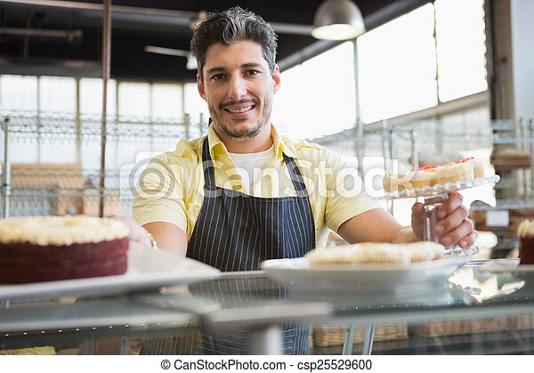 Attractive worker in apron posing - csp25529600