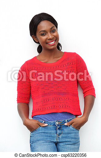attractive young african american woman smiling against white background - csp63220356
