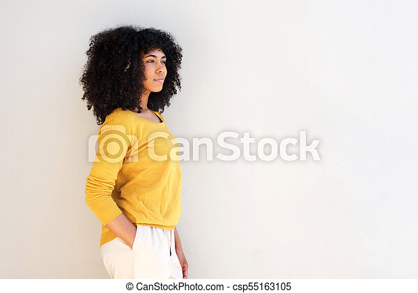 attractive young african american woman standing against white background - csp55163105