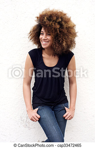 Attractive young african woman smiling - csp33472465