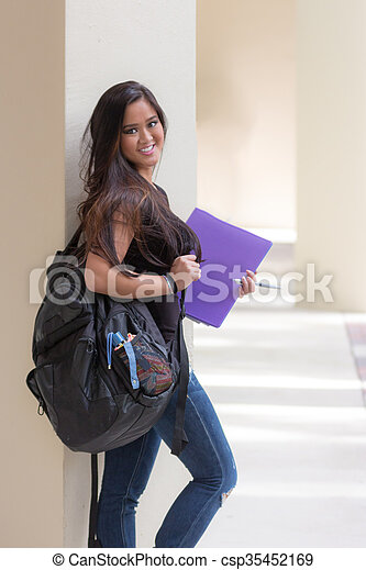 Attractive young asian woman student with backpack and binder on school campus - csp35452169