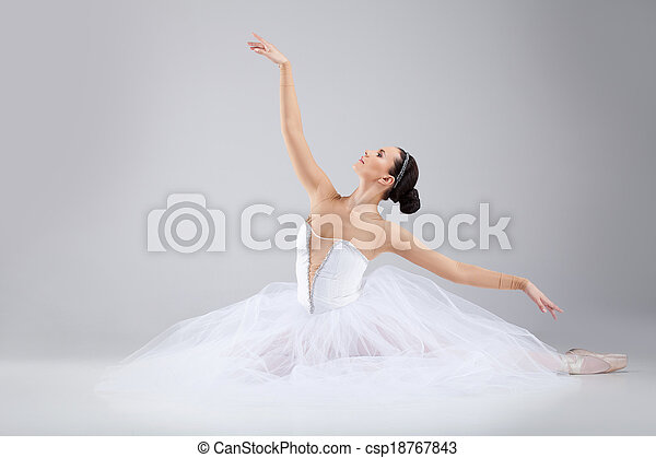 attractive young ballet dancer acting out. beautiful ballerina sitting forward split - csp18767843