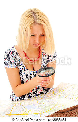 Attractive young blonde studying map - csp8865154
