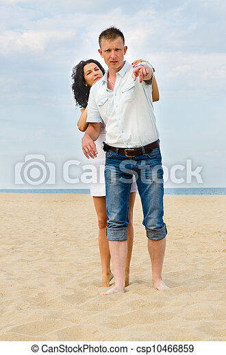 Attractive young couple on a beach - csp10466859