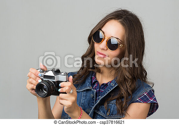 attractive young girl with a camera - csp37816621