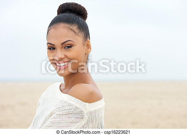 Attractive young lady looking over shoulder and smiling - csp16223621