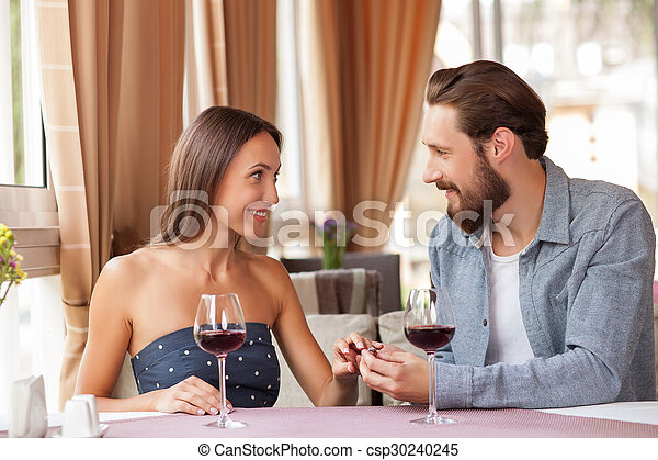 Attractive young loving couple is celebrating in restaurant - csp30240245