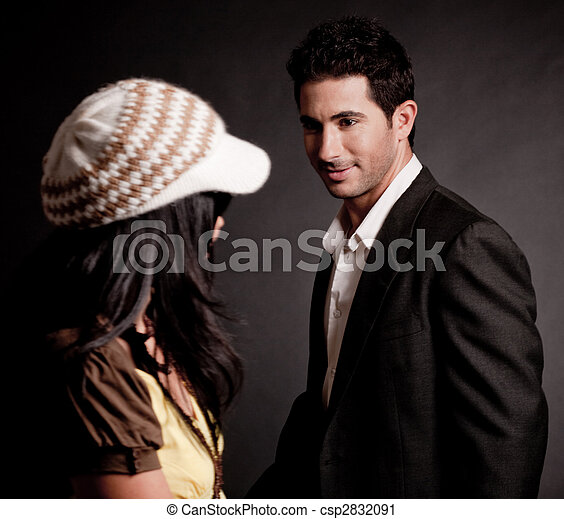 Attractive young man looking at trendy woman - csp2832091