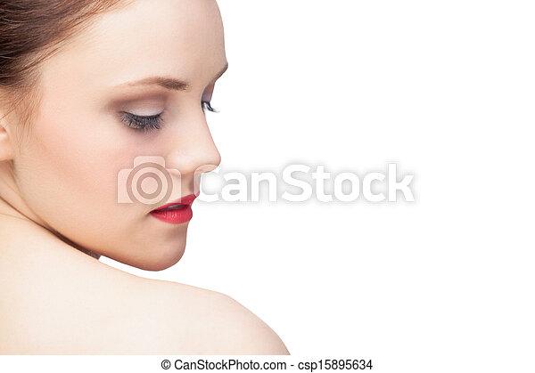 Attractive young model looking over shoulder - csp15895634