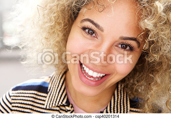 Attractive young modern african american woman smiling - csp40201314