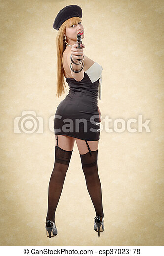 attractive young sexy woman with a gun - csp37023178