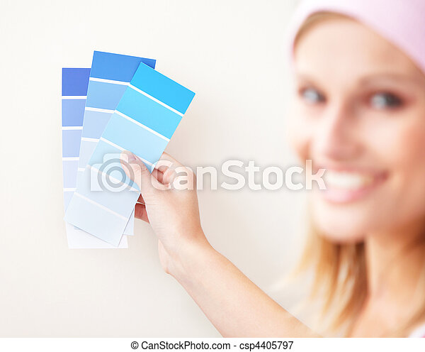 Attractive young woman choosing color for painting a room - csp4405797