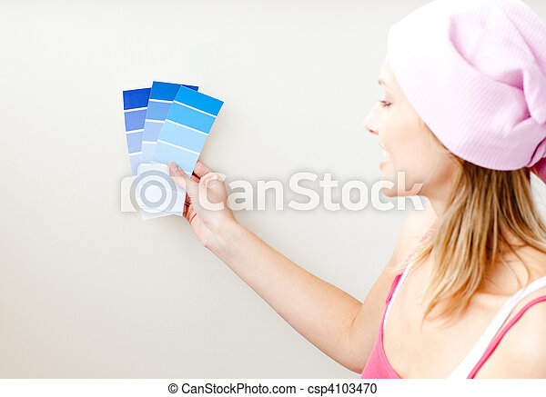Attractive young woman choosing color for painting a room  - csp4103470