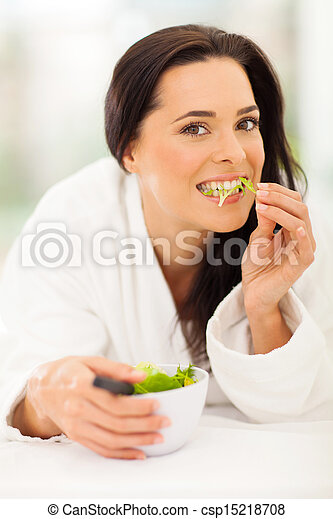 attractive young woman eating salad - csp15218708