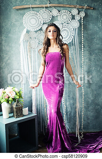 Attractive Young Woman in Gorgeous Dress - csp58120909