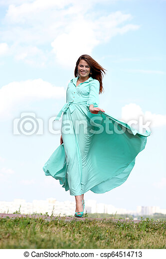 Attractive young woman in green dress - csp64514713