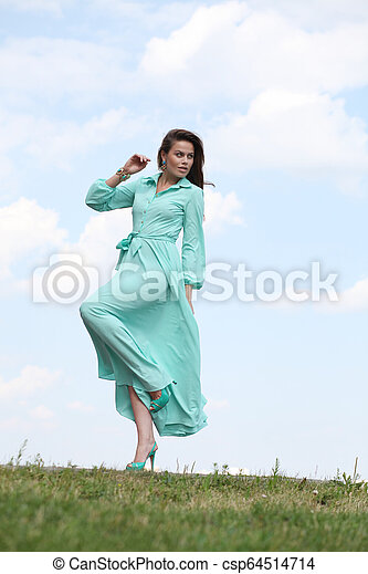 Attractive young woman in green dress - csp64514714