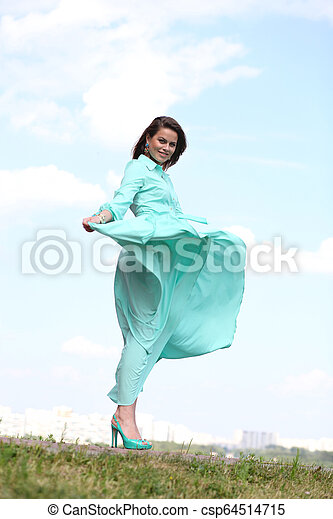 Attractive young woman in green dress - csp64514715
