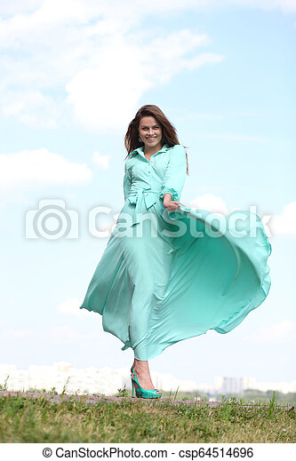 Attractive young woman in green dress - csp64514696