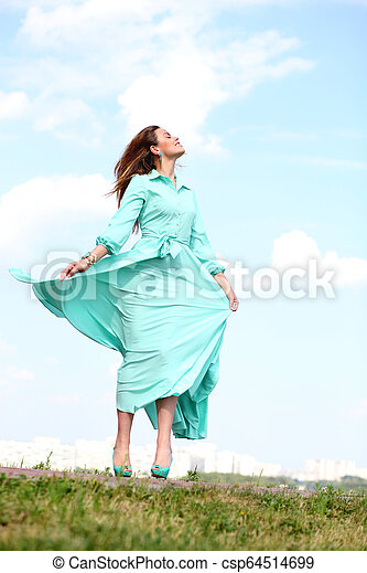 Attractive young woman in green dress - csp64514699