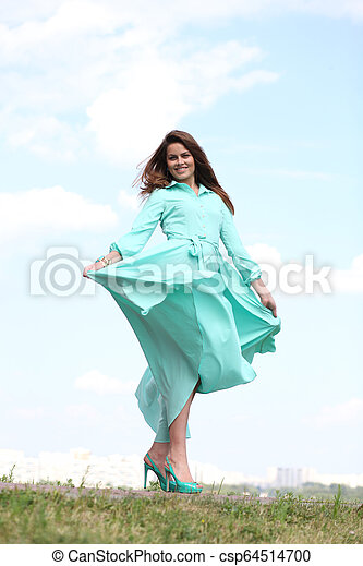 Attractive young woman in green dress - csp64514700