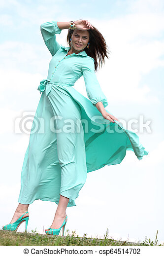 Attractive young woman in green dress - csp64514702