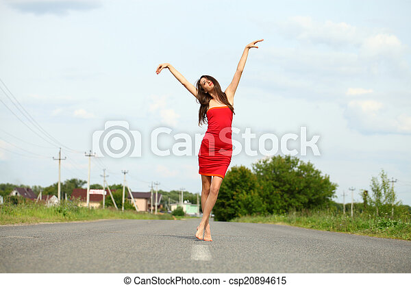 Attractive young woman in red dress - csp20894615