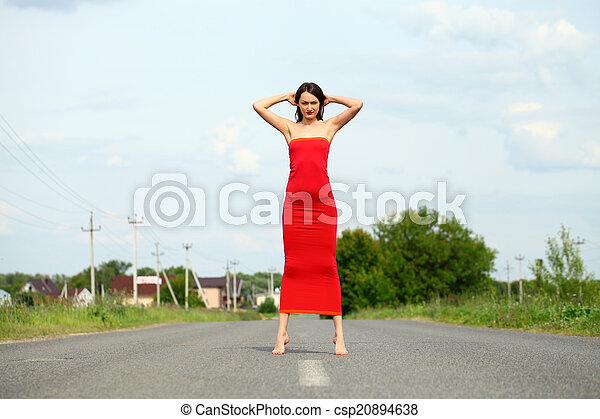 Attractive young woman in red dress - csp20894638