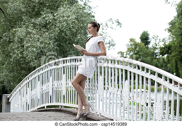 Attractive young woman in white dress - csp14519389