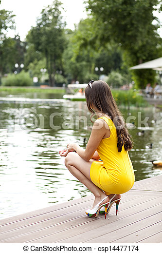 Attractive young woman in yellow dress - csp14477174