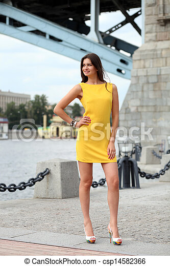 Attractive young woman in yellow dress - csp14582366