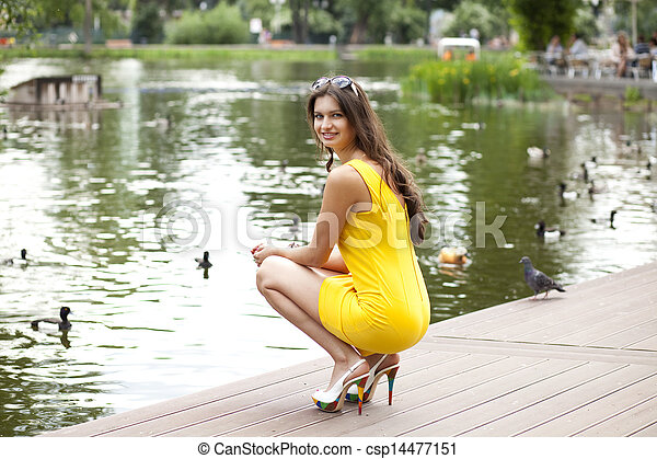 Attractive young woman in yellow dress - csp14477151