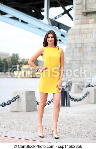Attractive young woman in yellow dress - csp14582356