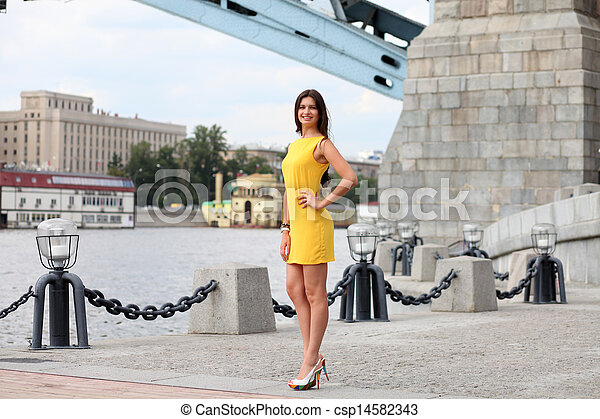 Attractive young woman in yellow dress - csp14582343