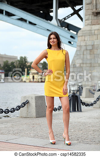 Attractive young woman in yellow dress - csp14582335