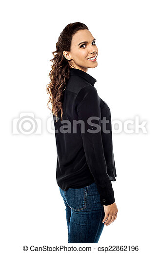 Attractive young woman looking back  - csp22862196