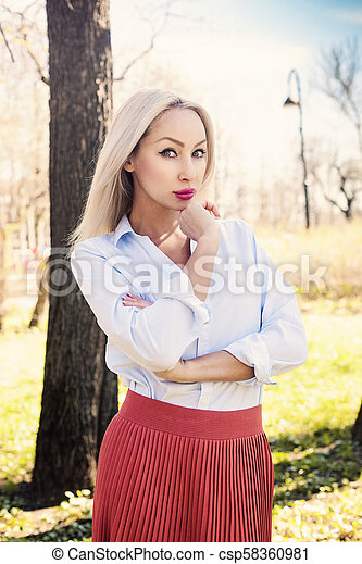 Attractive young woman, outdoors portrait - csp58360981
