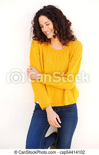 attractive young woman smiling against white background - csp54414102