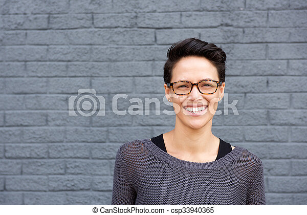 Close up portrait of an attractive young woman smiling with glasses