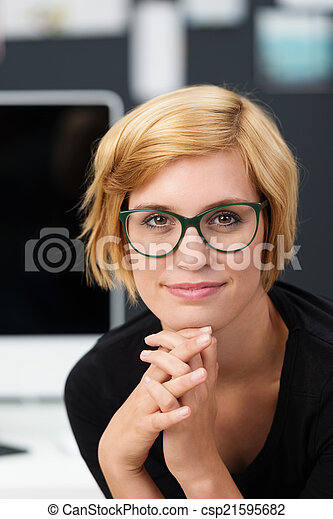 Attractive young woman wearing glasses - csp21595682