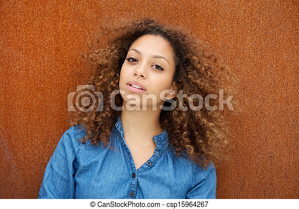 Attractive young woman with curly hair - csp15964267