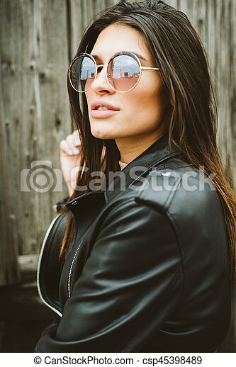 Attractive young woman with sunglasses - csp45398489