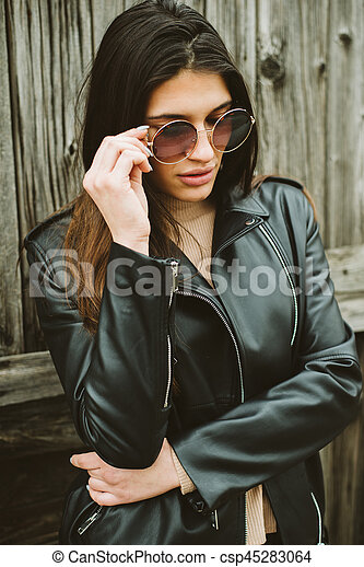 Attractive young woman with sunglasses - csp45283064