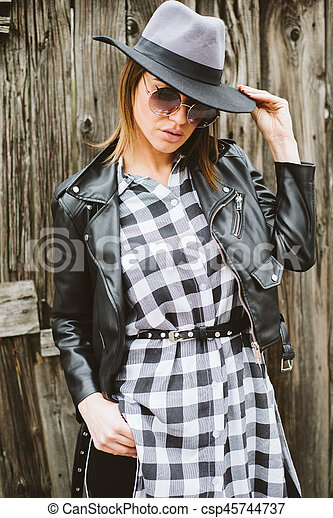 Attractive young woman with sunglasses - csp45744737
